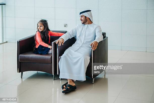 Father and little girl having fun at shopping mall