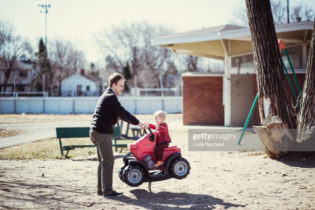 Father and little girl playing in the park : Stock Photo