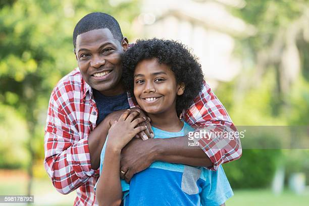 Father and mixed race preteen son