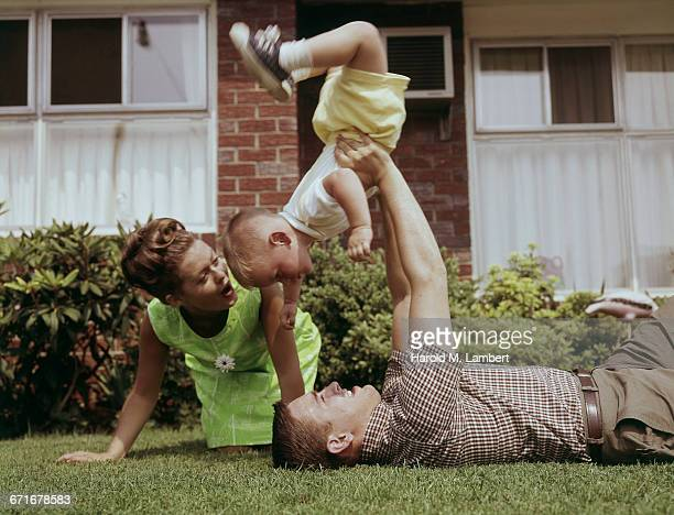 father and mother playing with baby boy in lawn  - {{relatedsearchurl(carousel.phrase)}} fotografías e imágenes de stock