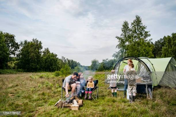 father and mother with children on springtime camping trip - offspring stock pictures, royalty-free photos & images