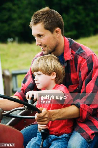 Father and on driving tractor