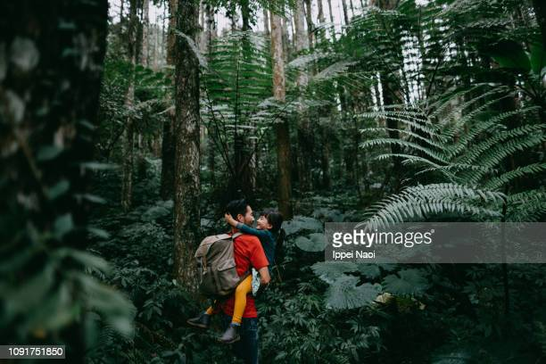 Father and preschool daughter having intimate moment in jungle