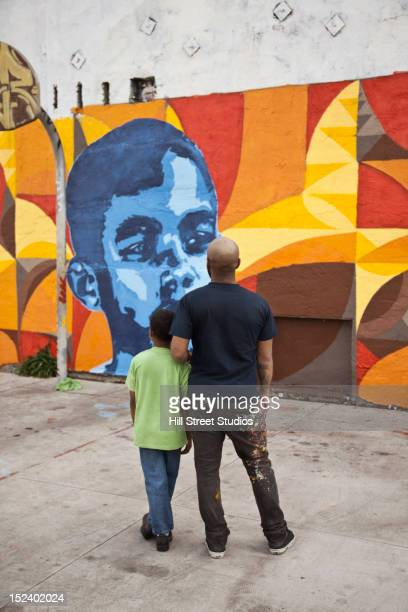 Father and son admiring mural