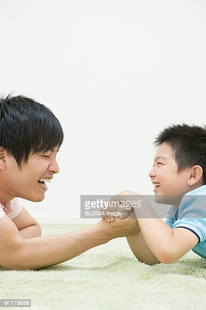 Father and son arm-wrestling