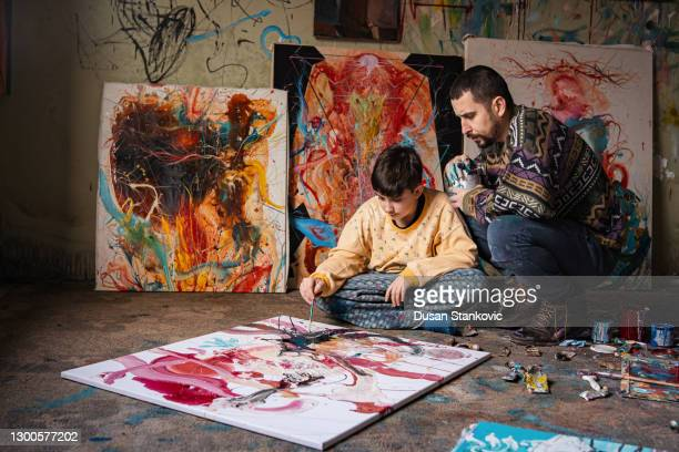 father and son artists spending day together - art show stock pictures, royalty-free photos & images