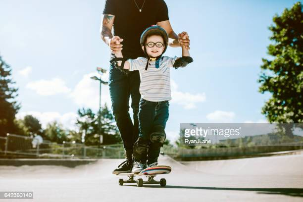 Father and Son at Skateboard Park