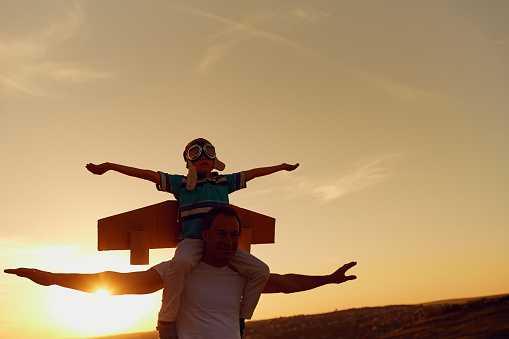 Father and son  at sunset in natur 964220192
