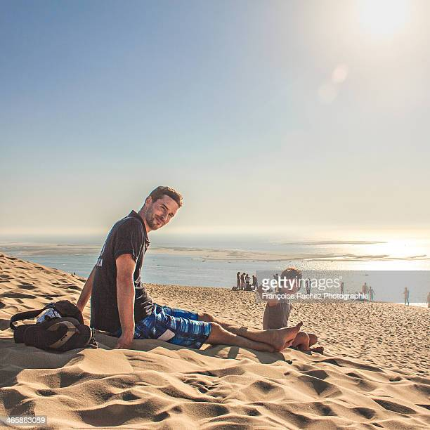 father and son at the beach - gironde stock pictures, royalty-free photos & images