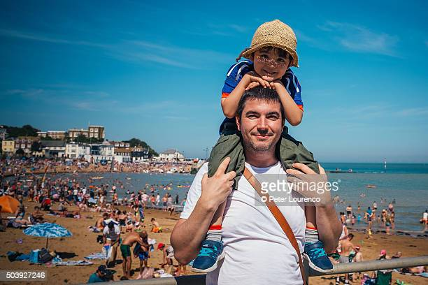 father and son at the beach - peter lourenco stock-fotos und bilder