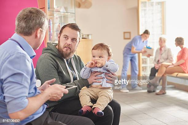 father and son at the clinic