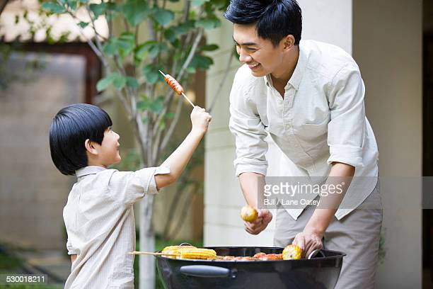 Father and son barbecuing