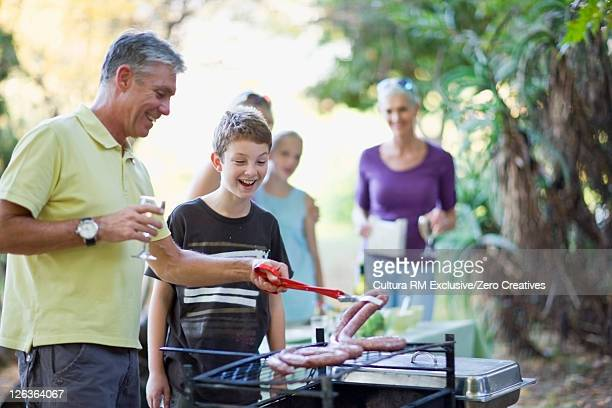 Father and son barbecuing together