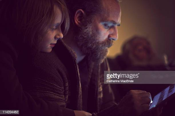 Father and Son bonding over tablet computer