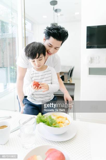 Father and son breakfast in the kitchen