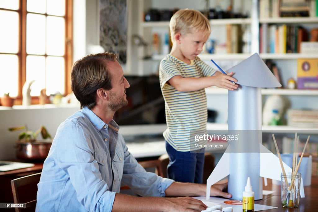 Father and son building rocket : Stock Photo
