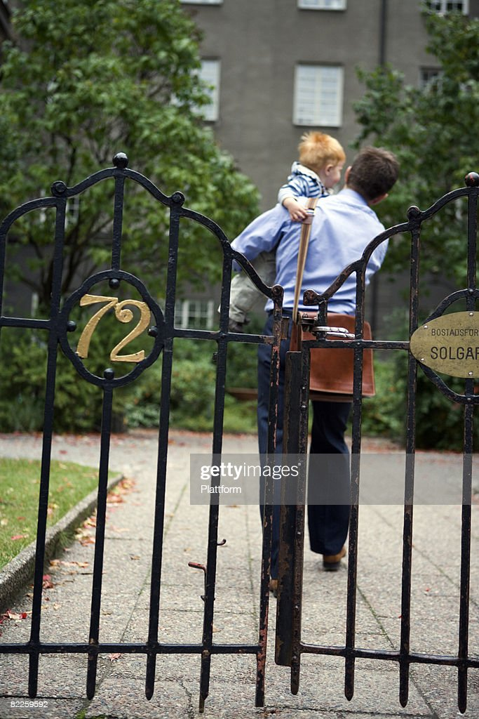 Father and son by a fence Sweden. : Stock Photo
