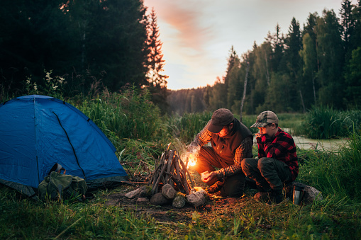 Father and son camping together 833226490