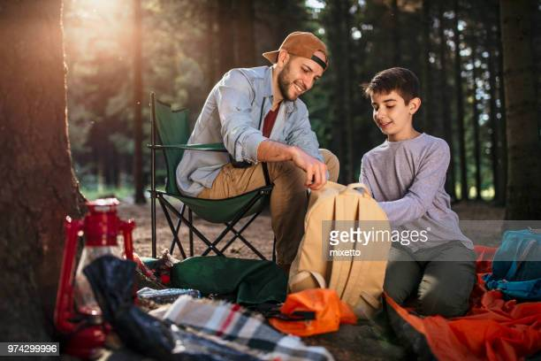 Father and son camping together