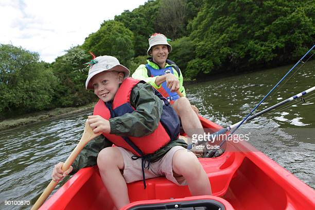 father and son canoeing