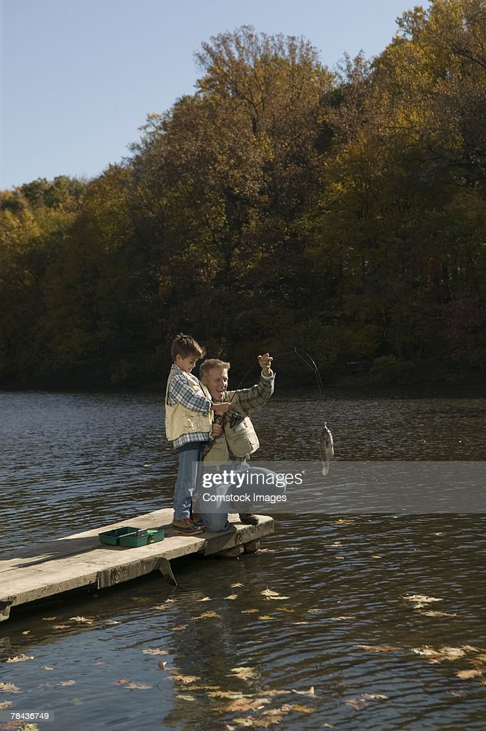 Father and son catching a fish : Stockfoto
