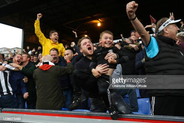 Father and son celebrate the equalising Newcastle goal during the Premier League match between Crystal Palace and Newcastle United at Selhurst Park...