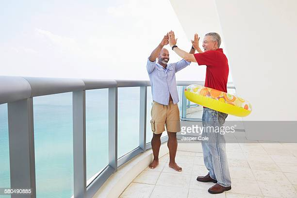 Father and son cheering in inflatable ring