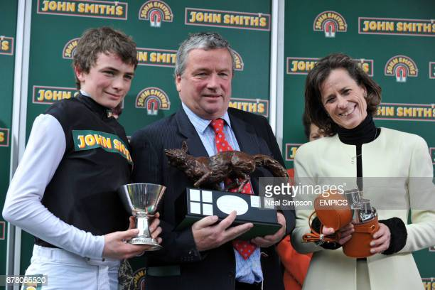 Father and son combination of trainer Nigel TwistonDavies and jockey Willie TwistonDavies receive the trophy after victory on board Baby Run in The...