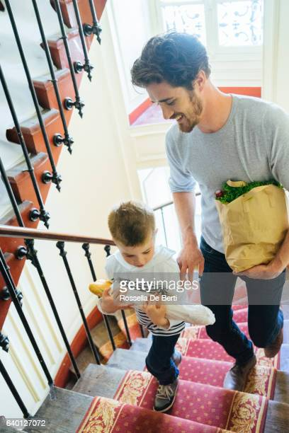 Father And Son Coming Back Home With Fresh Food