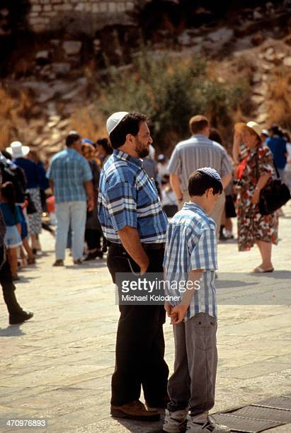 CONTENT] A father and son consider the Western Wall considered the holiest site in the world by many Jews The family is the most basic social unit...