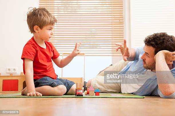 Father and son counting with fingers