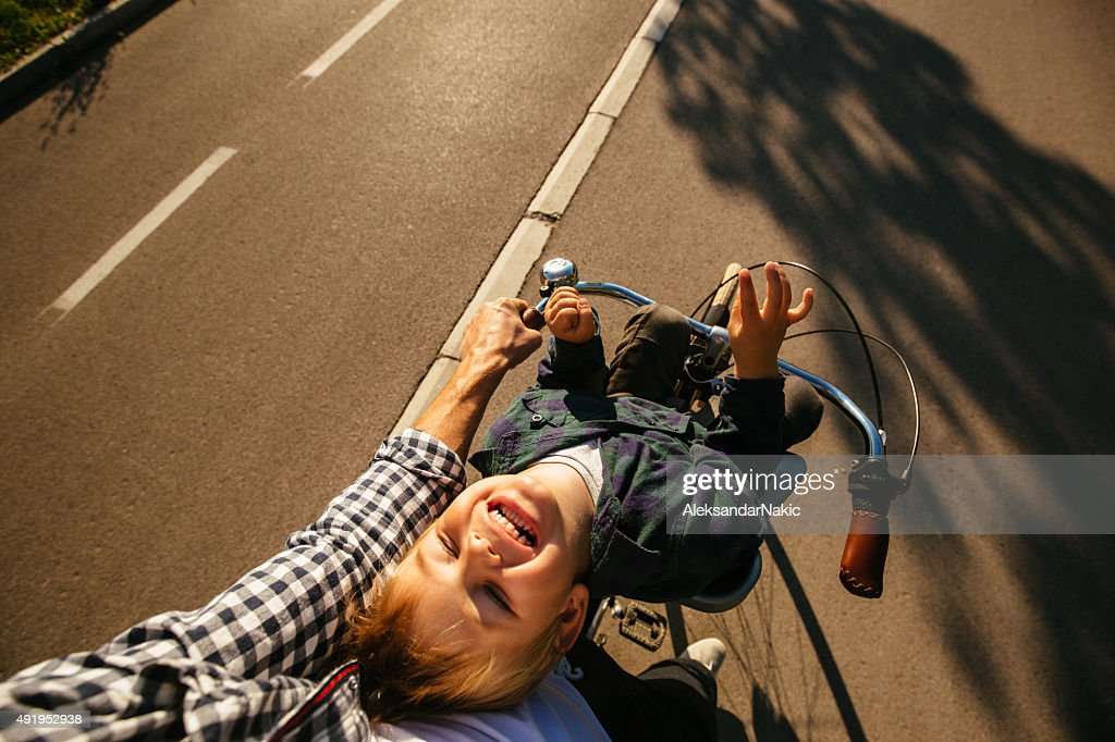 Father and son cycling together : Stock Photo