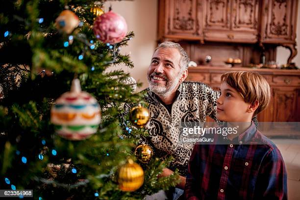 Father and Son Decorating the Christmas Tree