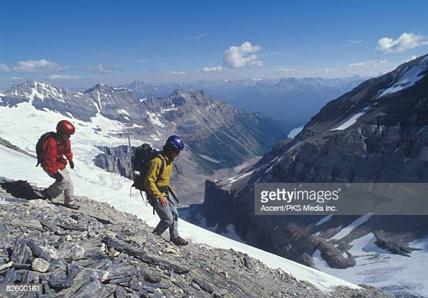 Father and son descending from mountain summit