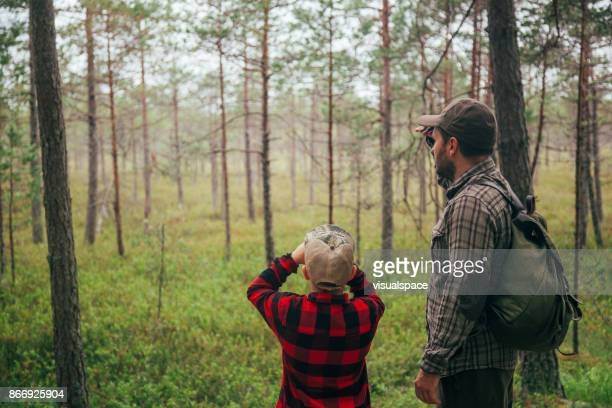 father and son discovering beauty in nature - bog stock photos and pictures