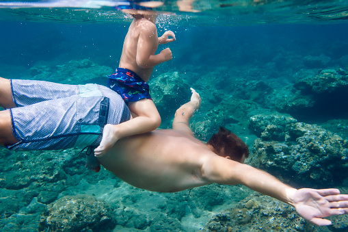 Father and son diving under water,Bali,Indonesia - gettyimageskorea