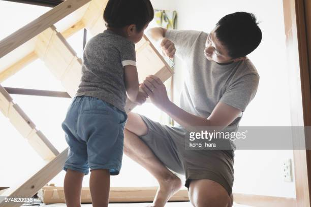 Father and son doing DIY at home together