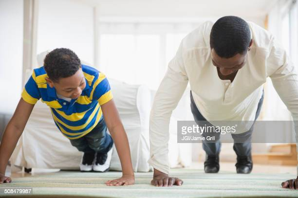 Father and son doing push ups together