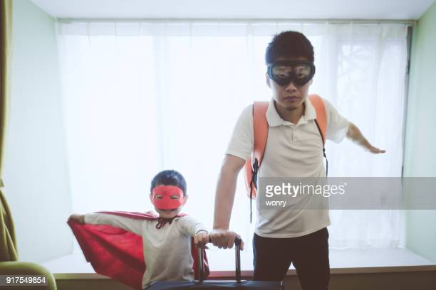 father and son dressed superhero indoors - crazy dad stock photos and pictures