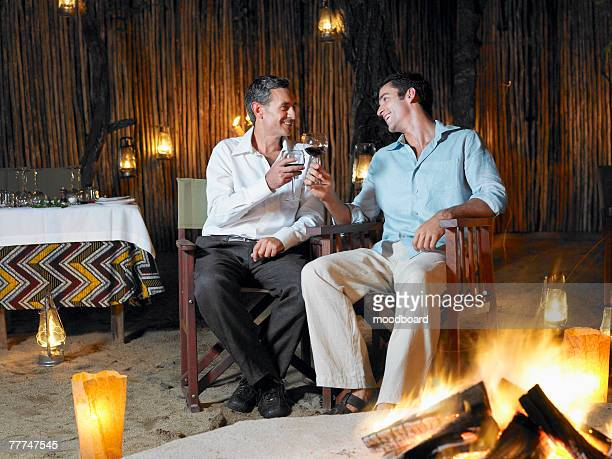 Father and Son Drinking Wine in an Exotic Restaurant