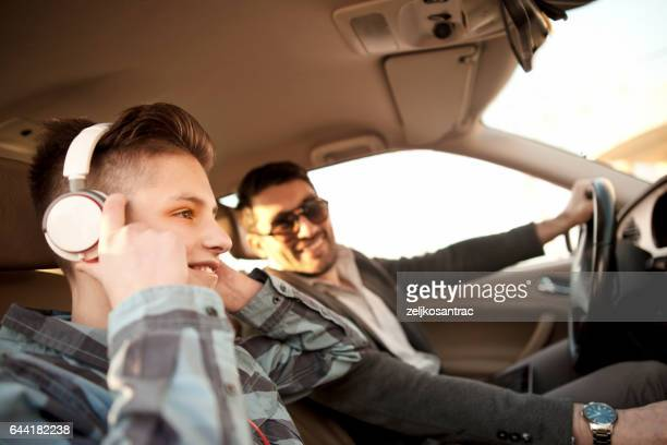 father and son driving in car - family inside car stock photos and pictures