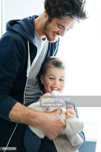 father and son drying hnds after washing teeth together - kin in de hand stock pictures, royalty-free photos & images