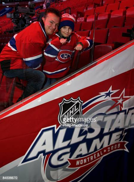 A father and son duo pose for a photo just outside of the dressing room to the Western Conference All Stars before NHL All Star Game at Bell Centre...