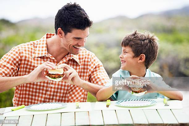 Father and Son Eating Hamburgers