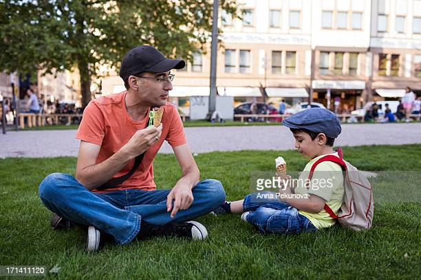 Father and son eating icecream