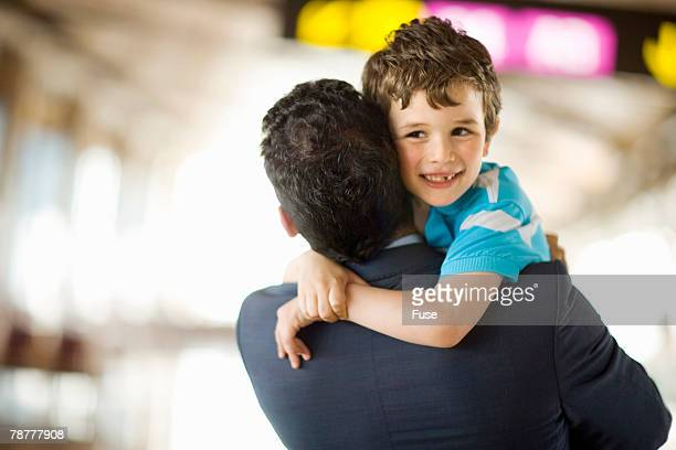 Father and Son Embracing at the Airport