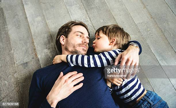 father and son embracing on the floor