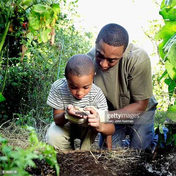 Father and son enjoy the natural garden