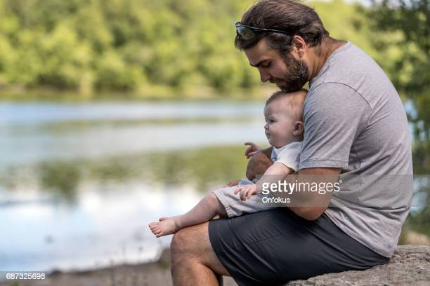 father and son enjoying a nice day at the park - close to stock pictures, royalty-free photos & images