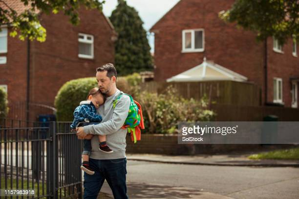 father and son enjoying a relaxing walk - carrying stock pictures, royalty-free photos & images